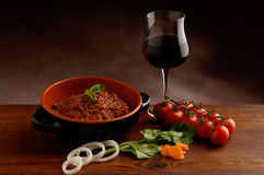 Ragu in bowl and  red wine Stock Photo