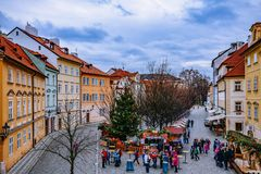 RAGUE, CZECH REPUBLIC - DECEMBER 22, 2015: Wooden stands offering souvenirs and traditional food during Christmas market. Taking place each year on December in royalty free stock photography