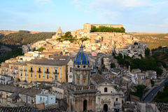 Ragusa Ibla, Italy. A panoramic view of Ragusa Ibla, Italy, at sunset with the Maiolica roofed bell tower of Santa Maria dell`Itria church in the foreground stock images