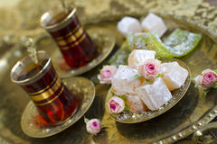 Rahat-lokum with tea and roses Royalty Free Stock Images
