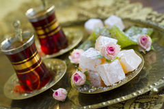 Rahat-lokum with tea and roses Royalty Free Stock Photography