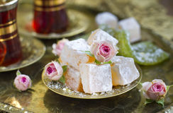 Rahat-lokum with tea and roses Stock Photos