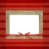 Rahmen für ein Foto oder Einladungen. Ein roter Bogen Lizenzfreie Stockbilder