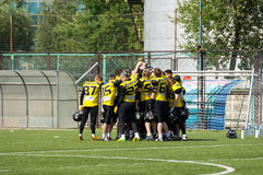Raiders52 team just before game. RUSSIA, TROITSK CITY - JULY 11:  Unidentified players of Raiders52 team just before Russian american football Championship game Royalty Free Stock Images