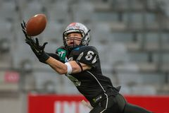 Raiders vs. Lions. INNSBRUCK, AUSTRIA - MAY 2, 2015: WR Kyle Callahan (#6 Raiders) catches the ball in a game of the Big SIx Football League Royalty Free Stock Image