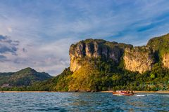 Raiding long tail boat in Railay beach before sunset in Krabi, T Stock Photos