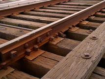 Rail. Side view of a track splice, road ties, spikes, etc as they appear on a classic way bridge Stock Photo