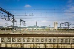 The railway across the city. Under blue sky Royalty Free Stock Photos