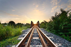 Rail aimed straight ahead to. Rail aimed straight ahead to the evening sky Stock Image