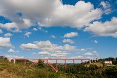 Red rail bridge Stock Images