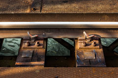 Rail on bridge over water detail Stock Image