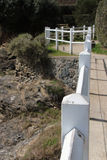 The rail built on the bank in Pornic (France) was painted in white Stock Photo