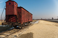 Rail Car with Auschwitz Birkenau Entrance in the Distance Royalty Free Stock Images