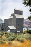 Rail Car Grain Elevator. A rail car grain elevator in eastern Oregon at Biggs Juntion on the Columbia River under cloudy skies Royalty Free Stock Image