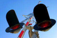 Rail Cro. Railroad Crossing signal from below with sky in the background Stock Image