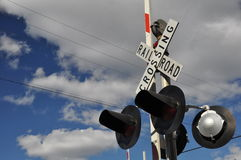 Rail crossing. Signal at a rail crossing in New England, USA on a sunny fall day stock photography