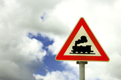 Rail crossing - road sign. Rail crossing road sign on a cloudy background Stock Photos