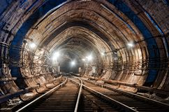 Rail crossing at subway tunnel stock images