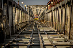 Rail crossing. View down the bridge over the river in Bratislava.  A pattern shot showing bridge girders Stock Photos