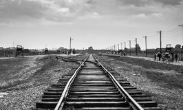 Rail entrance to concentration camp at Auschwitz Birkenau KZ Pol. And,classic historical view of Auschwitz death camp in black and white,Part of Auschwitz Royalty Free Stock Photos