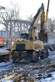Rail excavator. Excavators machine excavate on railway. Construction of the underpass under the railway in winter. Russia.  royalty free stock photos