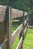 Rail Fence. Old wooden slat rail fence outside horse pasture Royalty Free Stock Photography