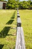 Rail Fence Across Green Grass Stock Photos