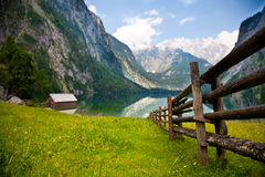 Rail fence in Alps. Wooden fence in Alps mountains stock photo