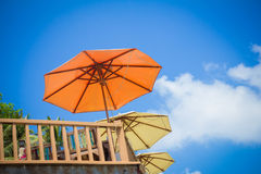 Rail fence and umbrellas on the sky background Royalty Free Stock Photography