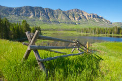 Rail Fence in Wyoming Mountains Stock Images