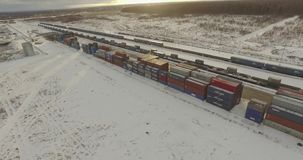 Rail freight marshalling yard. Moscow, Russia - January 15, 2017: Aerial view of freight trains with cargo containers on a sunny winter day in Moscow, Russia on stock footage