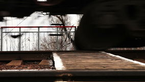 Rail freight train rumbles by wheels.  stock footage