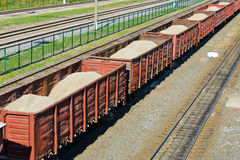 Rail freight wagons with sand Royalty Free Stock Photo