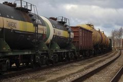 Rail fuel tank transport by rail in freight trains. Rail fuel tank transport by rail with goods tanks and containers, transportation, petroleum, shipment, goods stock photos