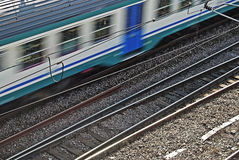 Rail intersection with passing train. Close-up of rail intersection with passing train fast Stock Image