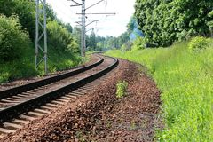 Rail journey squirm like a snake in the woods.  Stock Images