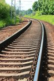 Rail journey squirm like a snake in the woods.  Royalty Free Stock Photography