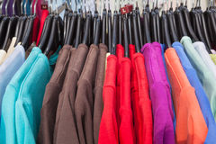 Rail of knitted jumpers in various colours Royalty Free Stock Photo