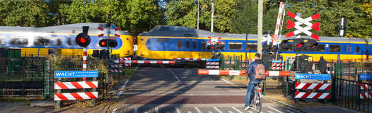 Rail level crossing double. A rail level crossing double near to railstation Ermelo Netherlands Royalty Free Stock Image
