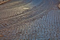Rail lines on cobbled road surface. Old rail lines on cobbled road surface Royalty Free Stock Photography