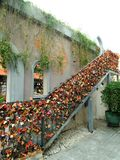 Rail of Love lock. Rail full of colourful heart and lock for secure love believes Stock Image