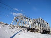 Rail metal bridge in winter against blue sky Stock Images