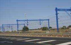 Rail Mounted Gantry Cranes beside a motorway or highway Royalty Free Stock Photo