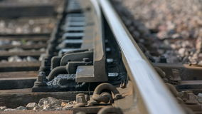 Rail open up to change the way for train. Close up RAW footage of a rail road moving to change the way for train in the middle of a countryside on a sunny day stock footage