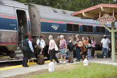 Rail passengers boarding train at DeLand Florida USA Stock Images