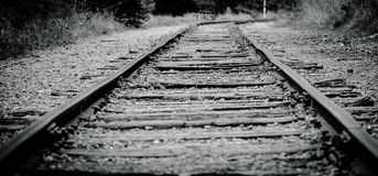The Rail Road. Black and White Rail Road Tracks that lead into a curve . Taken at Devils Lake State Park in Baraboo Wisconsin royalty free stock images
