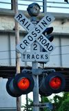 Rail Road Crossing. A look at crossing sign,while it red stock photo