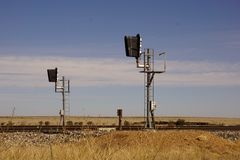 Rail road lights on the tracks. Royalty Free Stock Images
