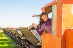 On the rail road. Pretty girl riding on the vintage rail road. In the train cabin Royalty Free Stock Photography