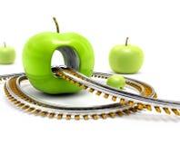 Rail road throw green apple Royalty Free Stock Photos